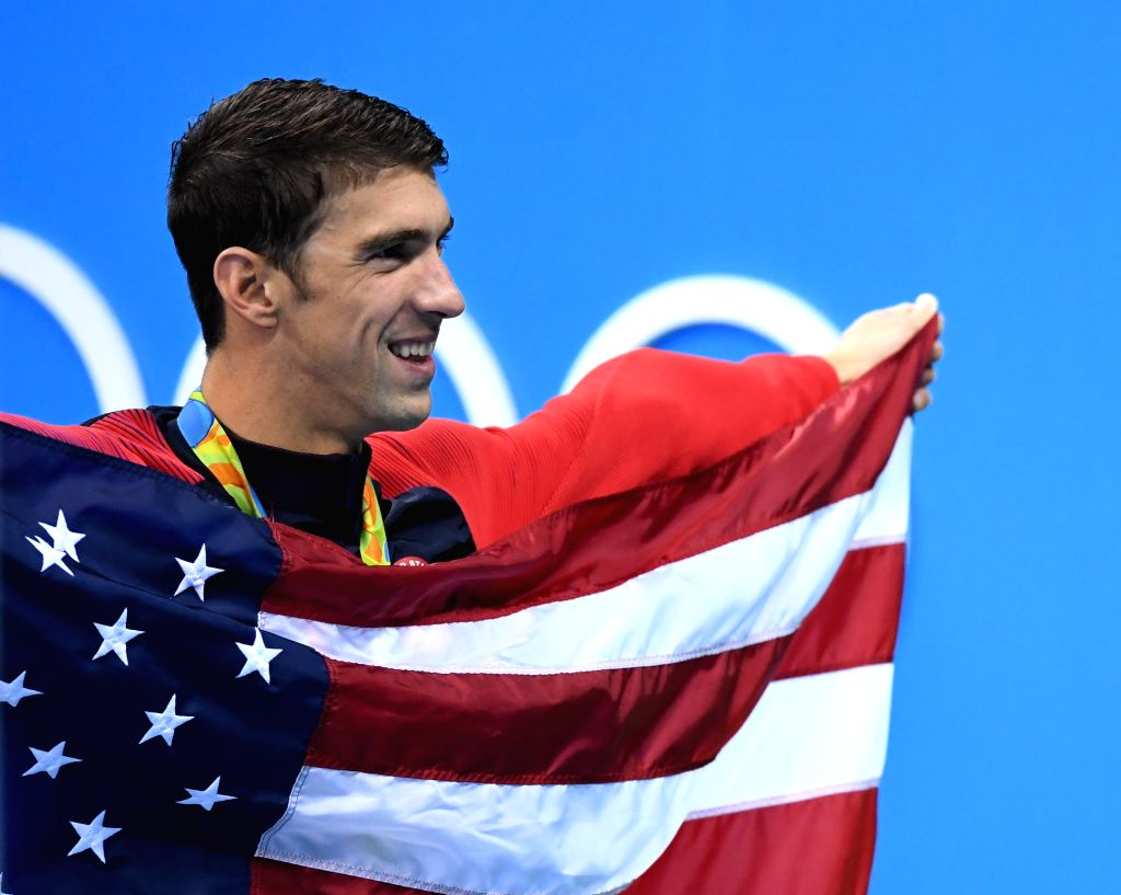 RIO DE JANEIRO, Aug. 13, 2016 - Michael Phelps of the United States celebrates at the awarding ceremony of the men's 4x100m medley relay final at the 2016 Rio Olympic Games in Rio de Janeiro, Brazil, ...