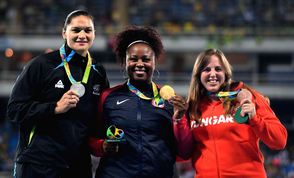 RIO DE JANEIRO, Aug. 13, 2016 - Michelle Carter of the United States (C), Valerie Adams of New Zealand (L) and Anita Marton of Hungary pose for a photo at the awarding ceremony of women's shot put at ...