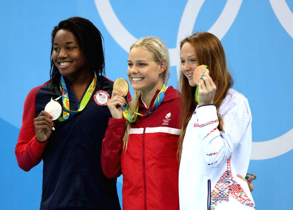 RIO DE JANEIRO, Aug. 13, 2016 - Pernille Blume of Denmark (C), Simone Manuel of the United States (L) and Aliaksandra Herasimenia of Belarus attend the awarding ceremony of the women's 50m freestyle ...