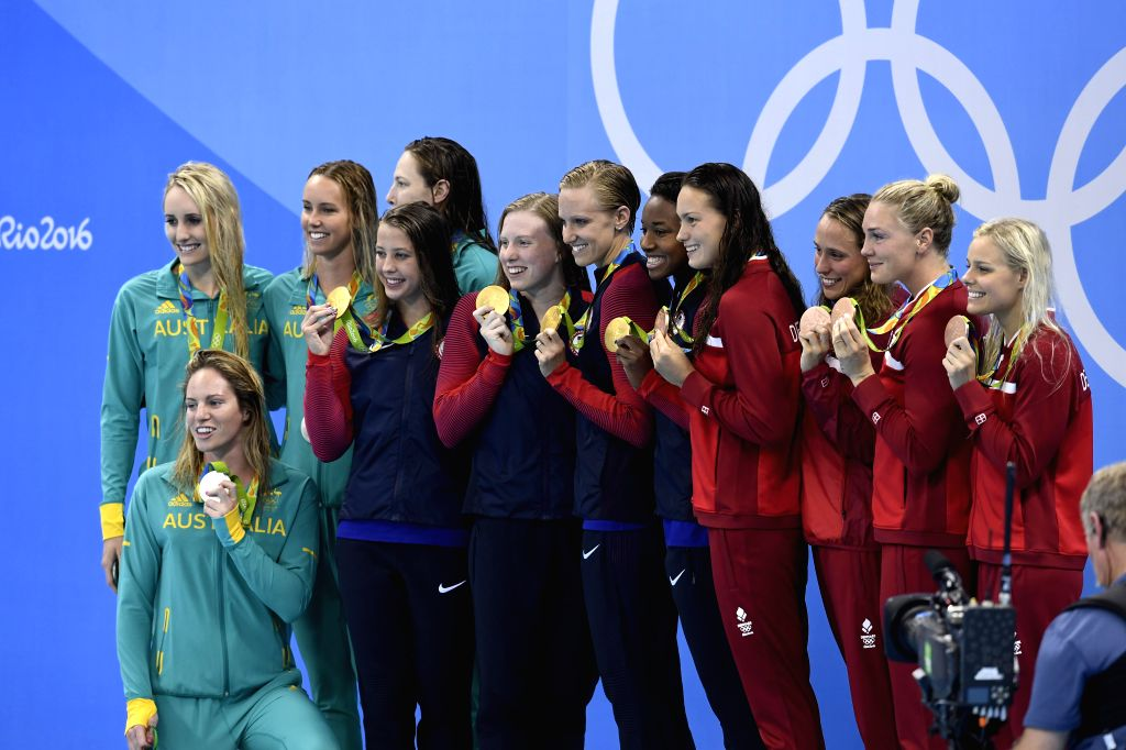 RIO DE JANEIRO, Aug. 13, 2016 - Players of Australia, the United States and Denmark (from L to R) attend the awarding ceremony of the women's 4x100m medley relay final at the 2016 Rio Olympic Games ...