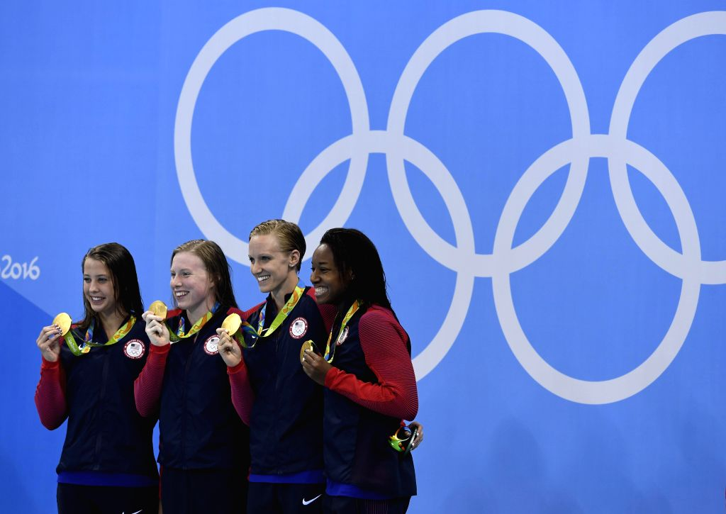 RIO DE JANEIRO, Aug. 13, 2016 - Players of the United States attend the awarding ceremony of the women's 4x100m medley relay final at the 2016 Rio Olympic Games in Rio de Janeiro, Brazil, on Aug. 13, ...