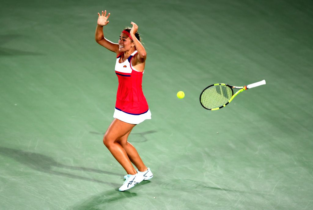 RIO DE JANEIRO, Aug. 13, 2016 - Puerto Rico's Monica Puig reacts after the women's singles gold medal match of Tennis against Germany's Angelique Kerber at the 2016 Rio Olympic Games in Rio de ...