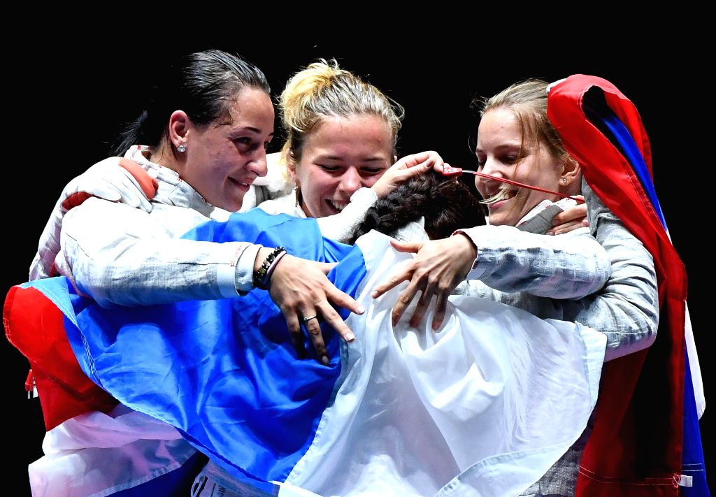 RIO DE JANEIRO, Aug. 13, 2016 - Russia's athletes celebrate after the women's sabre team gold medal match of Fencing against Ukraine at the 2016 Rio Olympic Games in Rio de Janeiro, Brazil, on Aug. ...