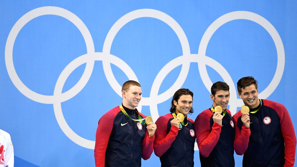 RIO DE JANEIRO, Aug. 13, 2016 - Ryan Murphy, Cody Miller, Michael Phelps and Nathan Adrian (from L to R) of the United States attend the awarding ceremony of the men's 4x100m medley relay final at ...
