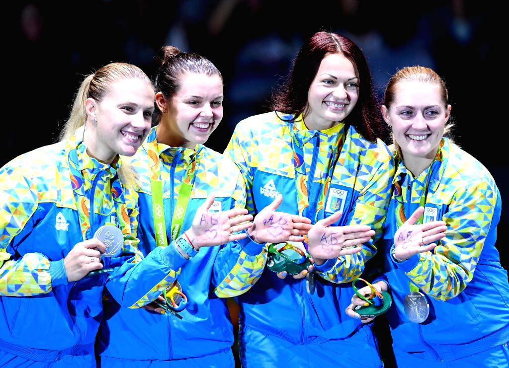 RIO DE JANEIRO, Aug. 13, 2016 - Silver medalists Ukraine's athletes attend the awarding ceremony for the women's sabre team final of Fencing at the 2016 Rio Olympic Games in Rio de Janeiro, Brazil, ...