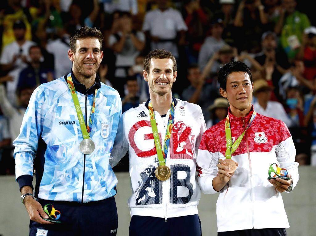 RIO DE JANEIRO, Aug. 14, 2016 - Andy Murray of Great Britain (C), Juan Martin Del Potro of Argentina (L) and Nishikori Kei of Japan attend the awarding ceremony of the men's tennis singles match at ...