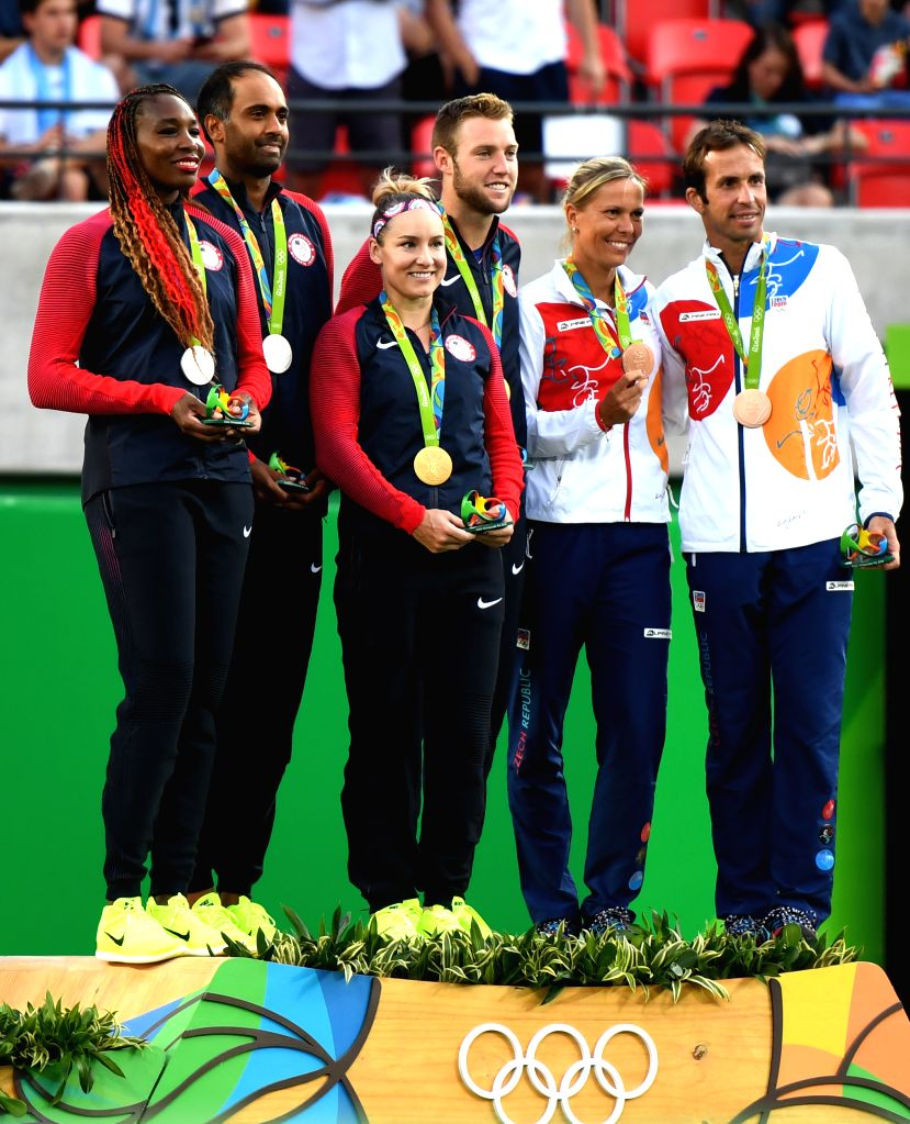 RIO DE JANEIRO, Aug. 14, 2016 - Bethanie Mattek-Sands (3rd, L) and Jack Sock (4rd, L) of the United States of America attend the awarding ceremony for the mixed doubles final of Tennis at the 2016 ...