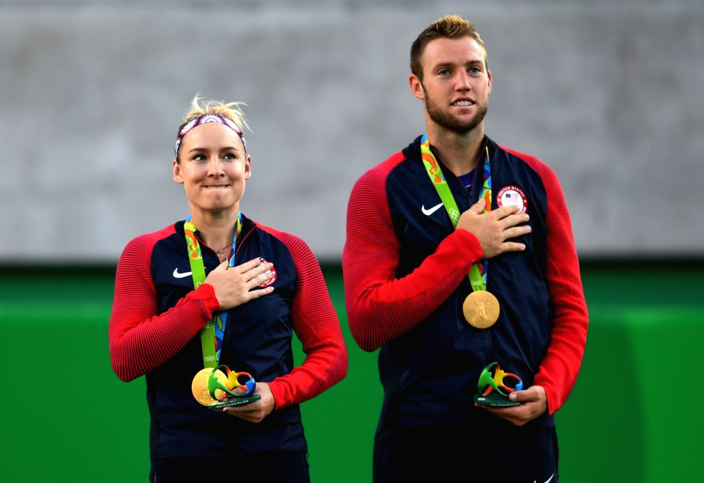 RIO DE JANEIRO, Aug. 14, 2016 - Bethanie Mattek-Sands (L) and Jack Sock of the United States of America attend the awarding ceremony for the mixed doubles final of Tennis at the 2016 Rio Olympic ...