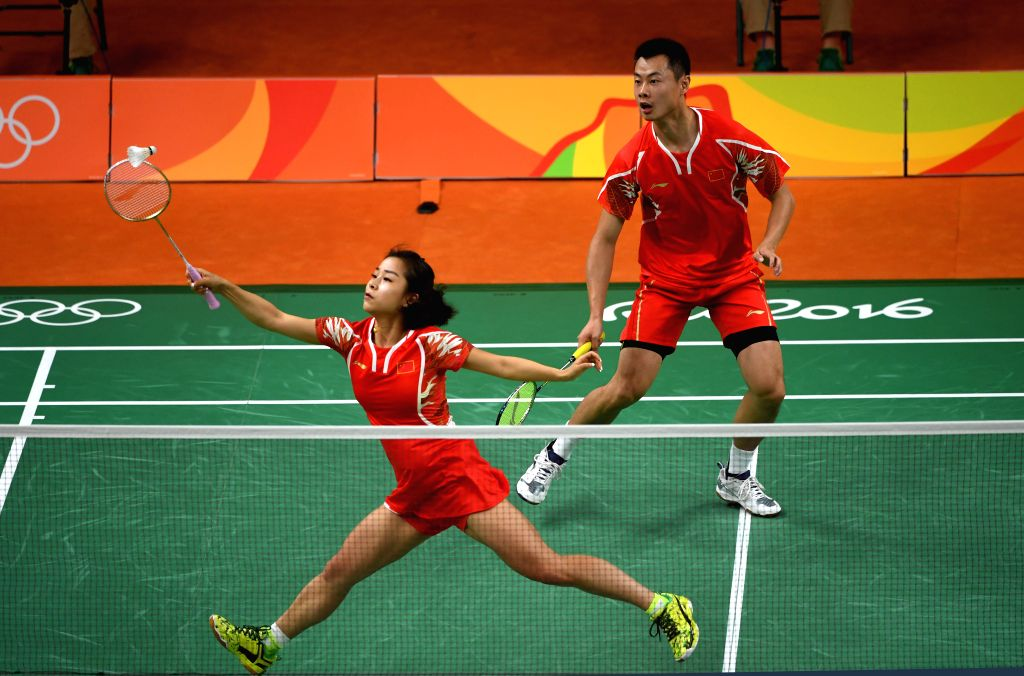 RIO DE JANEIRO, Aug. 14, 2016 - China's Xu Chen (R) and Ma Jin compete during the badminton mixed doubles quarterfinal against South Korea's Ko Sung Hyun and Kim Ha Na at the 2016 Rio Olympic Games ...