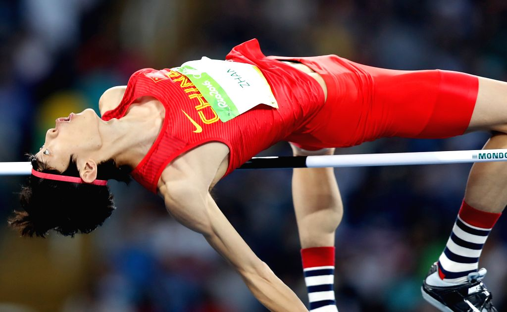 RIO DE JANEIRO, Aug. 14, 2016 - China's Zhang Guowei competes during the men's high jump qualification at the 2016 Rio Olympic Games in Rio de Janeiro, Brazil, on Aug. 14, 2016.