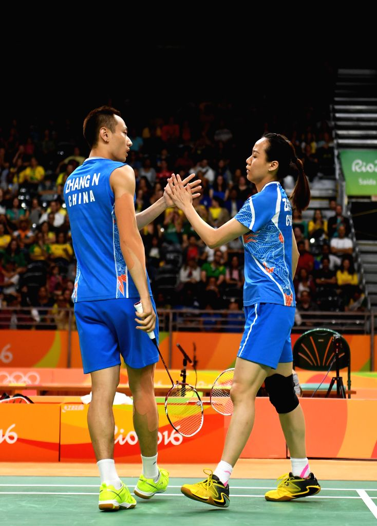 RIO DE JANEIRO, Aug. 14, 2016 - China's Zhang Nan (L) and Zhao Yunlei react during a mixed doubles quarterfinal of Badminton against Japan's Kenta Kazuno and Ayane Kurihara at the 2016 Rio Olympic ...