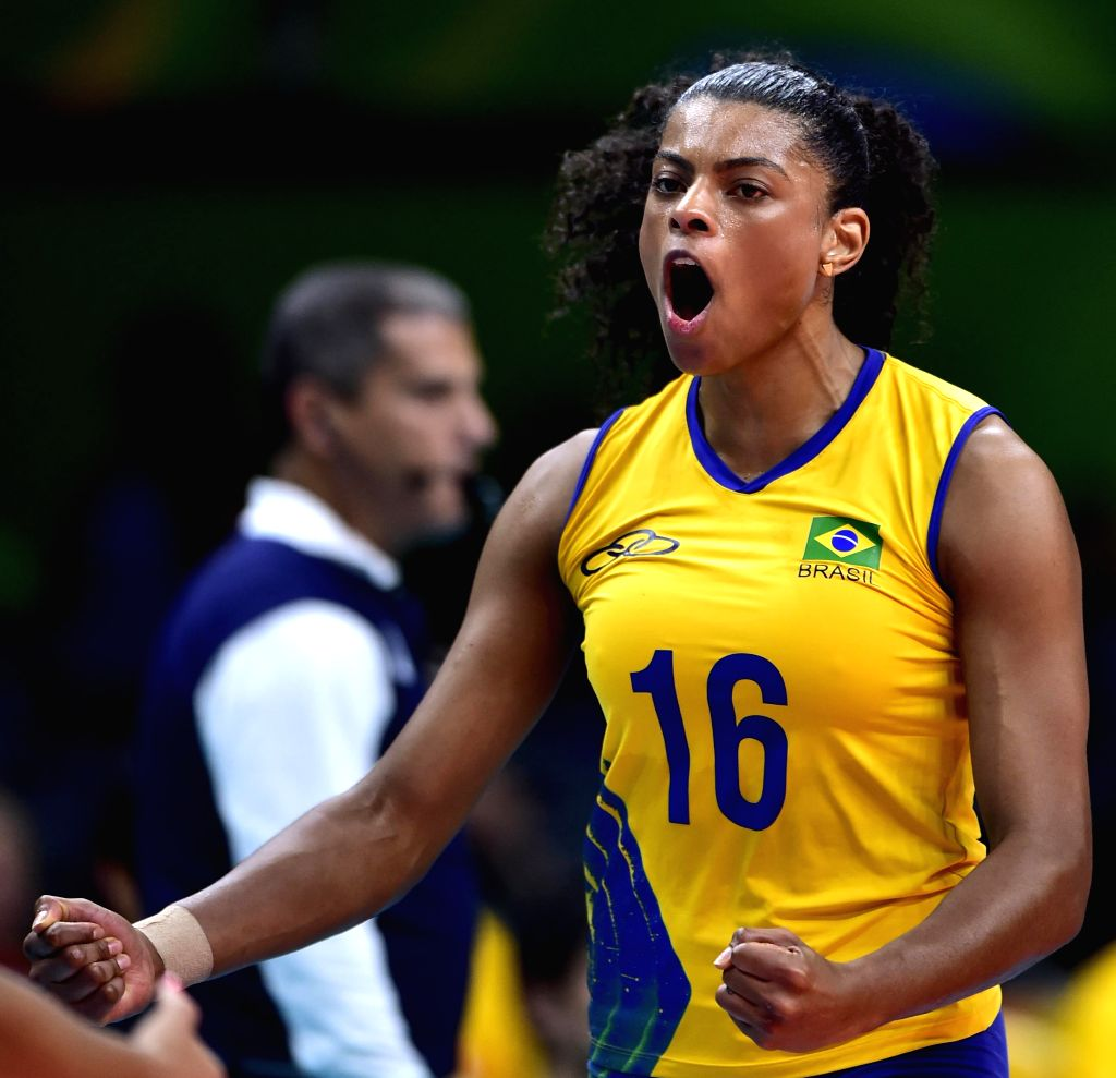 RIO DE JANEIRO, Aug. 14, 2016 - Fernanda Rodrigues of Brazil celebrates scoring during the women's volleyball preliminary pool A between Brazil and Russia at the 2016 Rio Olympic Games in Rio de ...