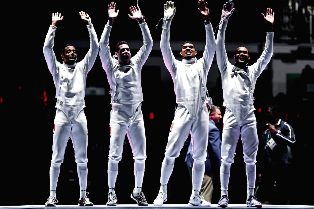 RIO DE JANEIRO, Aug. 14, 2016 - France's athletes celebrate during the men's epee team gold medal match of Fencing against Italy at the 2016 Rio Olympic Games in Rio de Janeiro, Brazil, on Aug. 14, ...