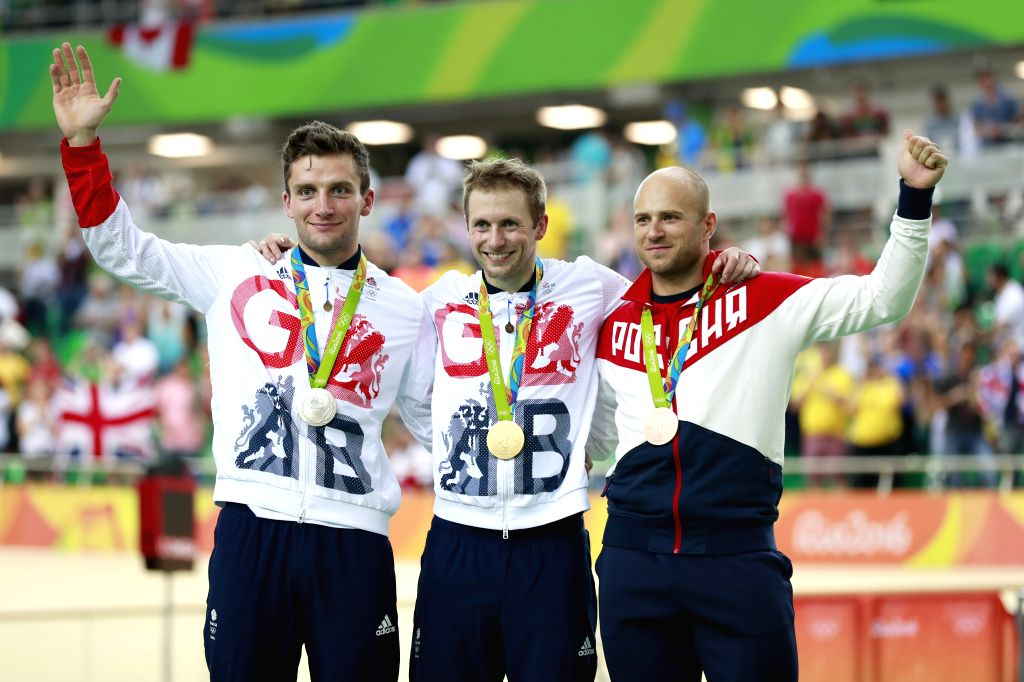 RIO DE JANEIRO, Aug. 14, 2016 - Gold medalist Britain's Jason Kenny (R), silver medalist Britain's Callum Skinner (L), bronze medalist Russia's Denis Dmitriev attend the awarding ceremony for the ...