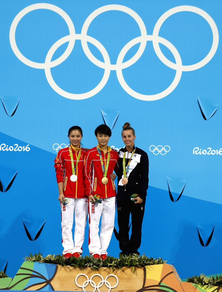 RIO DE JANEIRO, Aug. 14, 2016 - Gold medalist China's Shi Tingmao (C), silver medalist China's He Zi (L) and bronze medalist Italy's Tania Cagnotto pose for photos during the awarding ceremony for ...
