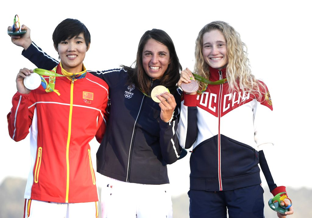 RIO DE JANEIRO, Aug. 14, 2016 - Gold medalist France's Charline Picon (C), silver medalist China's Chen Peina (L) and bronze medalist Russia's Stefaniya Elfutina attend the awarding ceremony for the ...