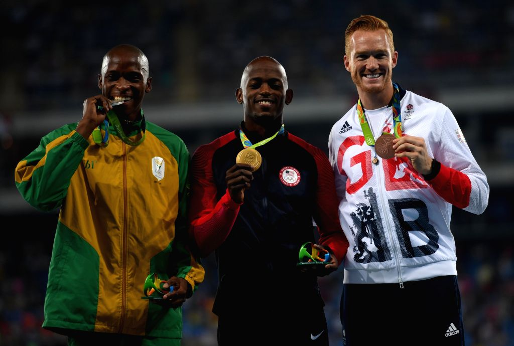 RIO DE JANEIRO, Aug. 14, 2016 - Jeff Henderson of the United States (C), Luvo Manyonga of South Africa (L) and Greg Rutherford of Great Britain attend the awarding ceremony of the men's long jump at ...