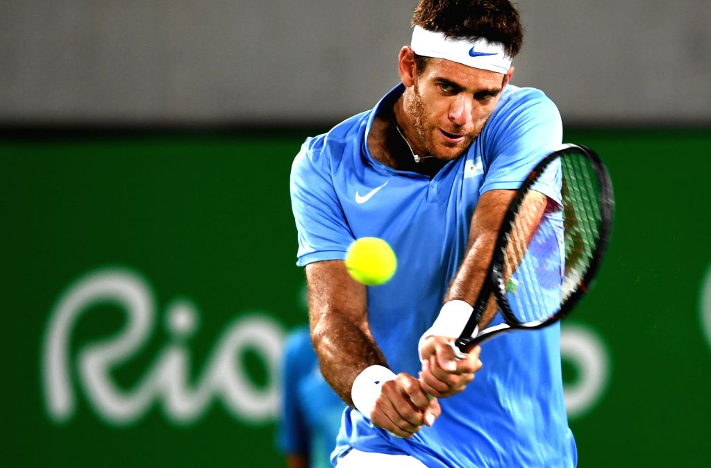 RIO DE JANEIRO, Aug. 14, 2016 - Juan Martin Del Potro of Argentina competes during the men's tennis singles gold medal match against Andy Murray of Great Britain at the 2016 Rio Olympic Games in Rio ...