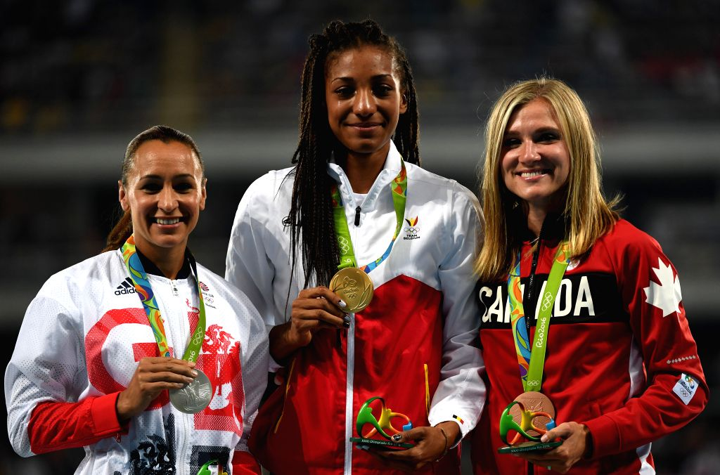 RIO DE JANEIRO, Aug. 14, 2016 - Nafissatou Thiam of Belgium (C), Jessica Ennis-Hill of Great Britain (L) and Brianne Theisen Eaton of Canada attend the awarding ceremony of the women's heptathlon at ...