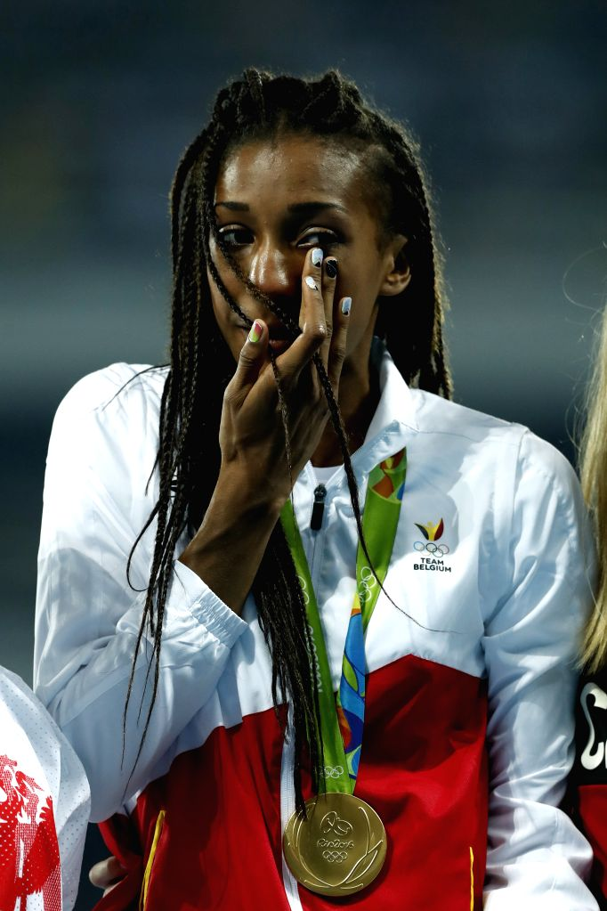 RIO DE JANEIRO, Aug. 14, 2016 - Nafissatou Thiam of Belgium attends the awarding ceremony of the women's heptathlon at the 2016 Rio Olympic Games in Rio de Janeiro, Brazil, on Aug. 14, 2016. ...