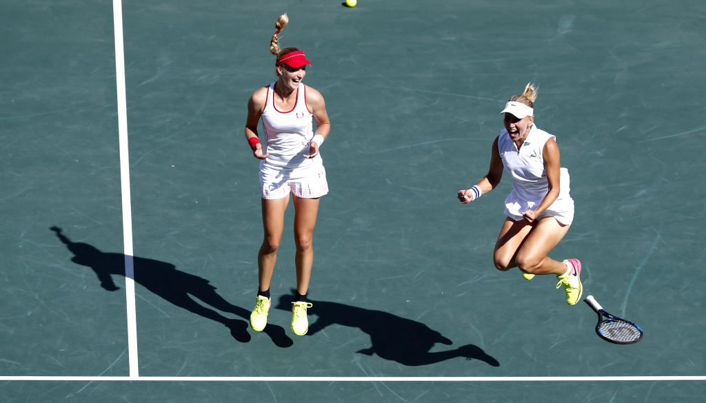 RIO DE JANEIRO, Aug. 14, 2016 - Russia's Elena Vesnina (R) and Ekaterina Makarova celebrate after the women's doubles gold medal match of Tennis against Switzerland's Martina Hingis and Timea ... - Martina Hingis