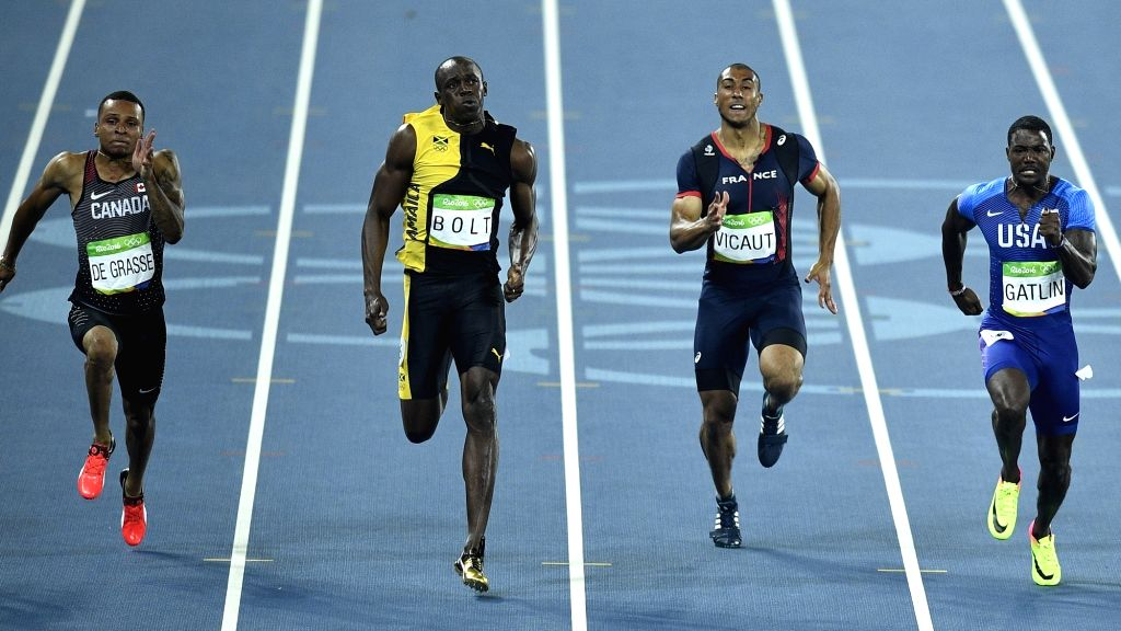 RIO DE JANEIRO, Aug. 14, 2016 - Usain Bolt of Jamaica (2nd L) competes during the final of men's 100m at the 2016 Rio Olympic Games in Rio de Janeiro, Brazil, on Aug. 14, 2016. Usain Bolt won the ...