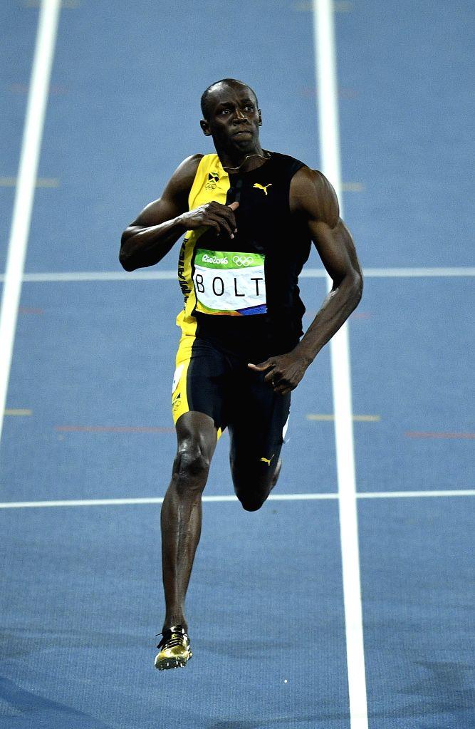 RIO DE JANEIRO, Aug. 14, 2016 - Usain Bolt of Jamaica celebrates after the final of men's 100m at the 2016 Rio Olympic Games in Rio de Janeiro, Brazil, on Aug. 14, 2016. Usain Bolt won the gold medal ...