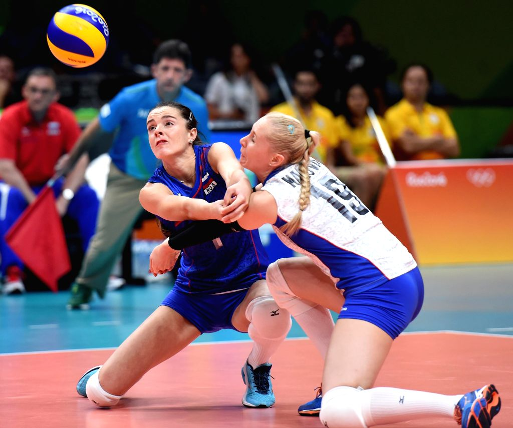 RIO DE JANEIRO, Aug. 14, 2016 - Yana Shcherban (L) and Anna Malova of Russia compete during the women's volleyball preliminary pool A between Brazil and Russia at the 2016 Rio Olympic Games in Rio de ...