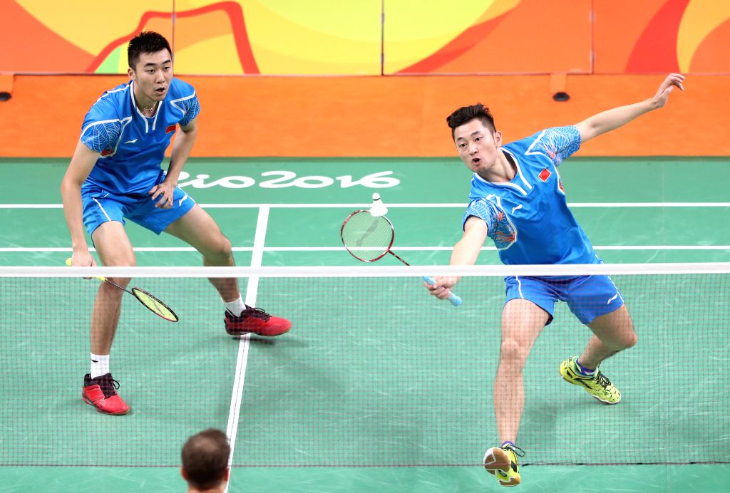 RIO DE JANEIRO, Aug. 15, 2016 - China's Chai Biao (R) and Hong Wei compete against Russia's Vladimir Ivanov and Ivan Sozonov during men's doubles quarterfinal of Badminton at the 2016 Rio Olympic ...