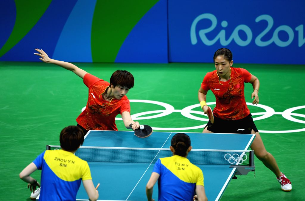 RIO DE JANEIRO, Aug. 15, 2016 - China's Ding Ning (top, L) and Liu Shiwen (top, R) compete during women's team semifinal of Tabel Tennis against Singapore at the 2016 Rio Olympic Games in Rio de ...