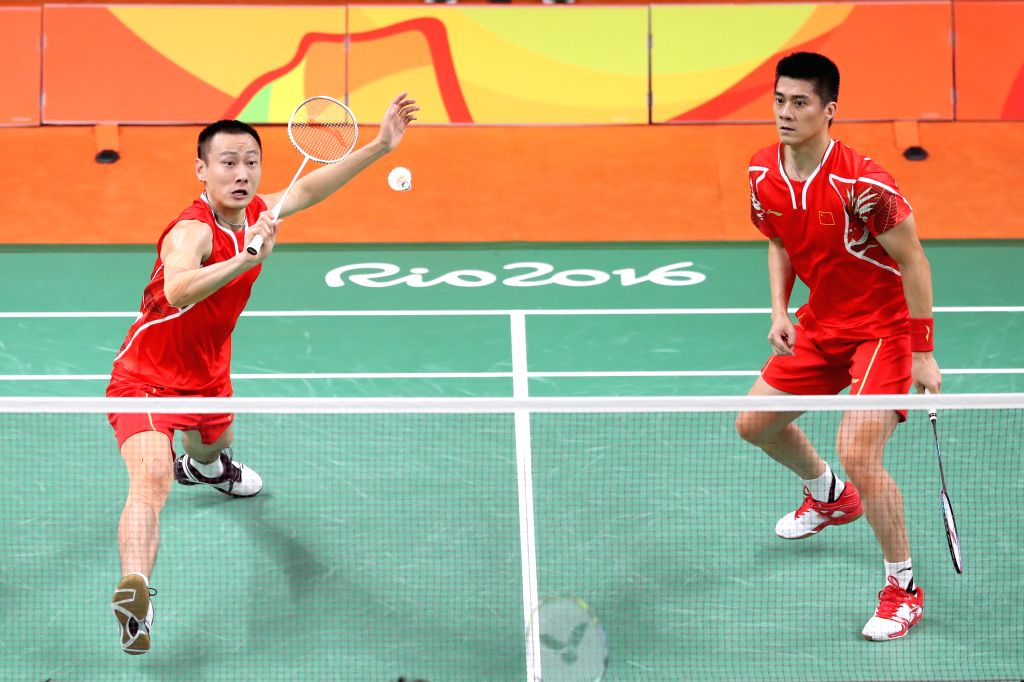 RIO DE JANEIRO, Aug. 15, 2016 - China's Fu Haifeng  (R) and Zhang Nan compete against South Korea's Kim Gi Jung and Kim Sa Rang during men's doubles quarterfinal of Badminton at the 2016 Rio Olympic ...