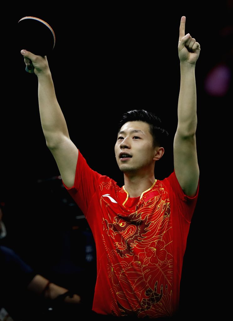RIO DE JANEIRO, Aug. 15, 2016 - China's Ma Long competes during the men's team gold medal match of Tabel Tennis against Japan at the 2016 Rio Olympic Games in Rio de Janeiro, Brazil, on Aug. 15, ...