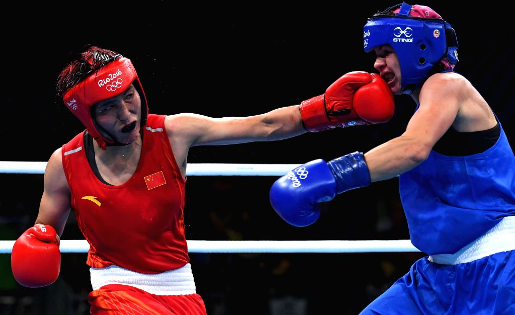 RIO DE JANEIRO, Aug. 15, 2016 - China's Yin Junhua (L) competes against Azerbaijan's Yana Alekseevna during women's light (57-60kg) quarterfinal of Boxing at the 2016 Rio Olympic Games in Rio de ...
