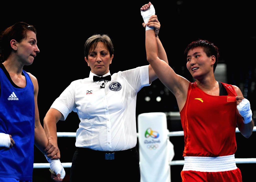 RIO DE JANEIRO, Aug. 15, 2016 - China's Yin Junhua (R) celebrates after women's light (57-60kg) quarterfinal of Boxing against Azerbaijan's Yana Alekseevna at the 2016 Rio Olympic Games in Rio de ...