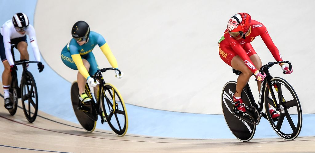 RIO DE JANEIRO, Aug. 15, 2016 - China's Zhong Tianshi (R) competes during a women?s sprint competition of Cycling Track at the 2016 Rio Olympic Games in Rio de Janeiro, Brazil, on Aug. 15, 2016.