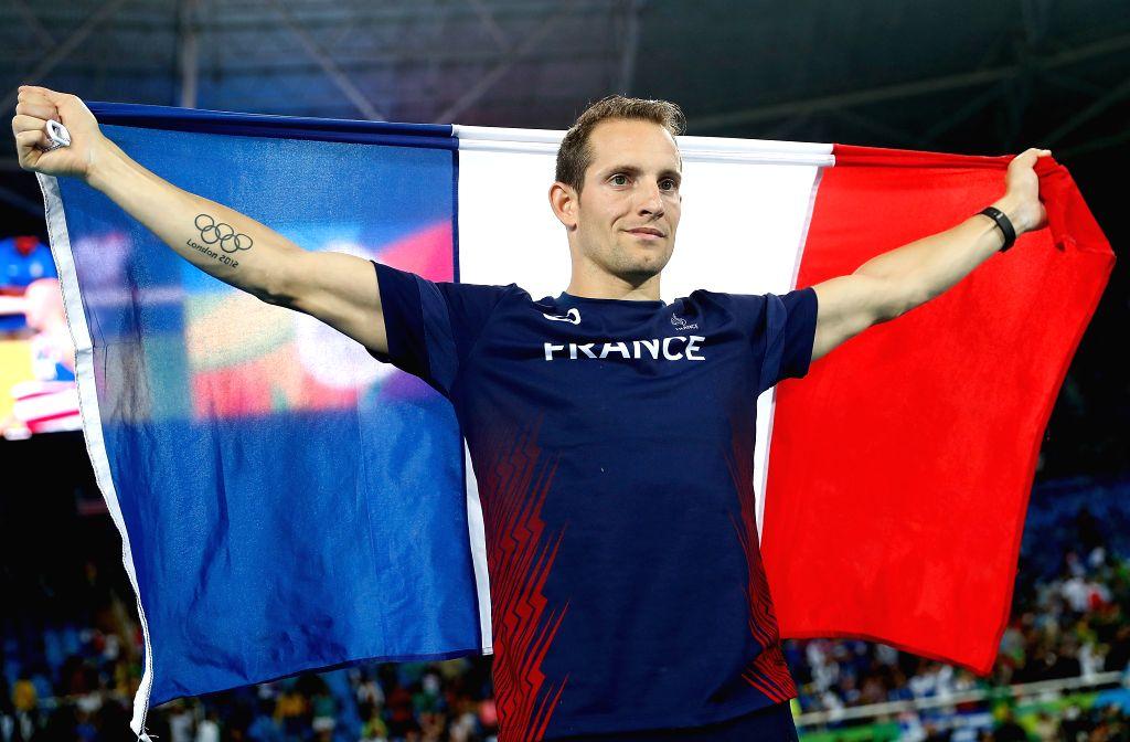 RIO DE JANEIRO, Aug. 15, 2016 - France's Renaud Lavillenie celebrates after the men's pole vault final at the 2016 Rio Olympic Games in Rio de Janeiro, Brazil, on Aug. 15, 2016.