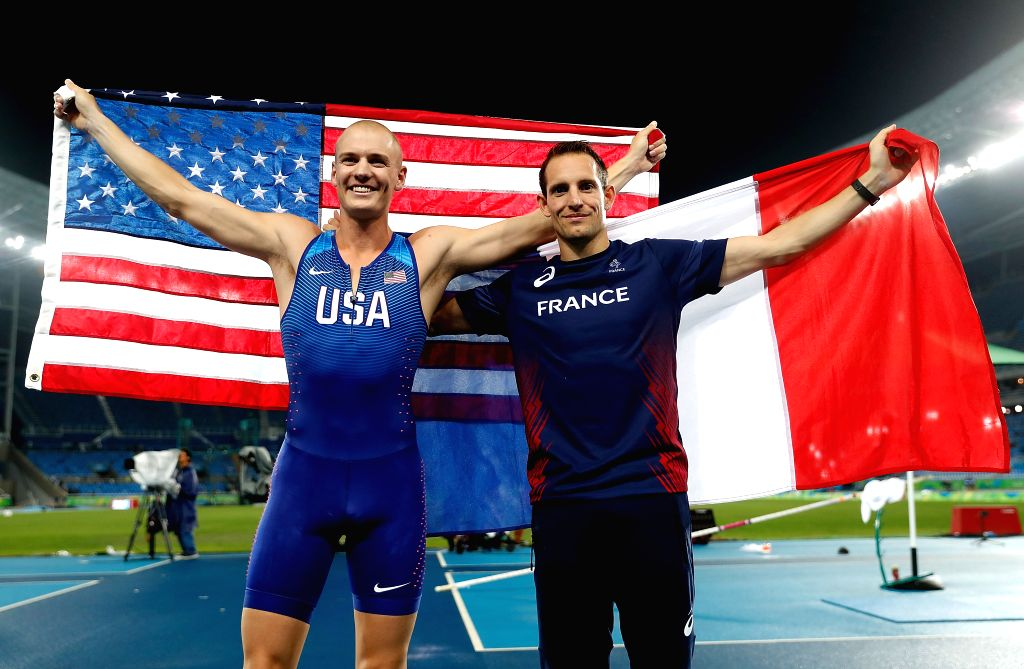 RIO DE JANEIRO, Aug. 15, 2016 - France's Renaud Lavillenie (R) and Sam Kendricks of the United States celebrate after the men's pole vault final at the 2016 Rio Olympic Games in Rio de Janeiro, ...