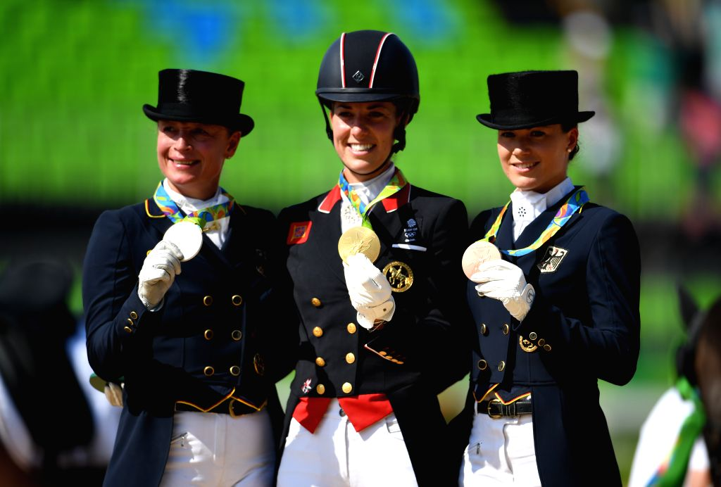 RIO DE JANEIRO, Aug. 15, 2016 - Gold medalist Britain's Charlotte Dujardin (C), silver medalist Germany's Isabell Werth (L) and bronze medalist Germany's Kristina Broring-Sprehe attend the awarding ...