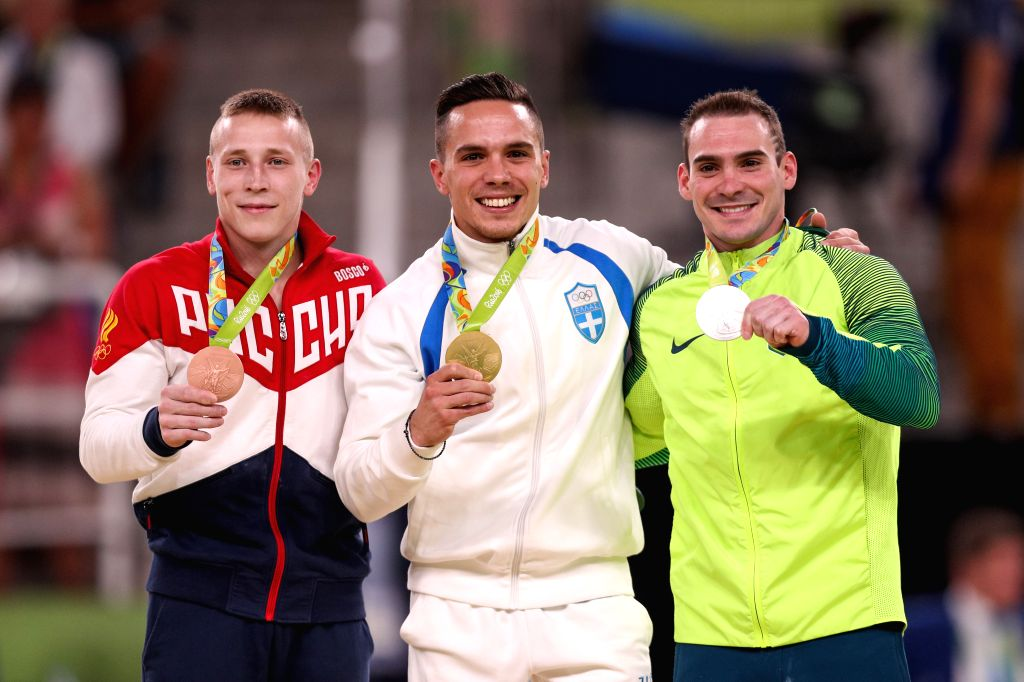 RIO DE JANEIRO, Aug. 15, 2016 - Gold medalist Greece's Eleftherios Petrounias (C), silver medalist Brazil's Arthur Zanetti (R), bronze medalist Russia's Denis Abliazin attend the awarding ceremony ...