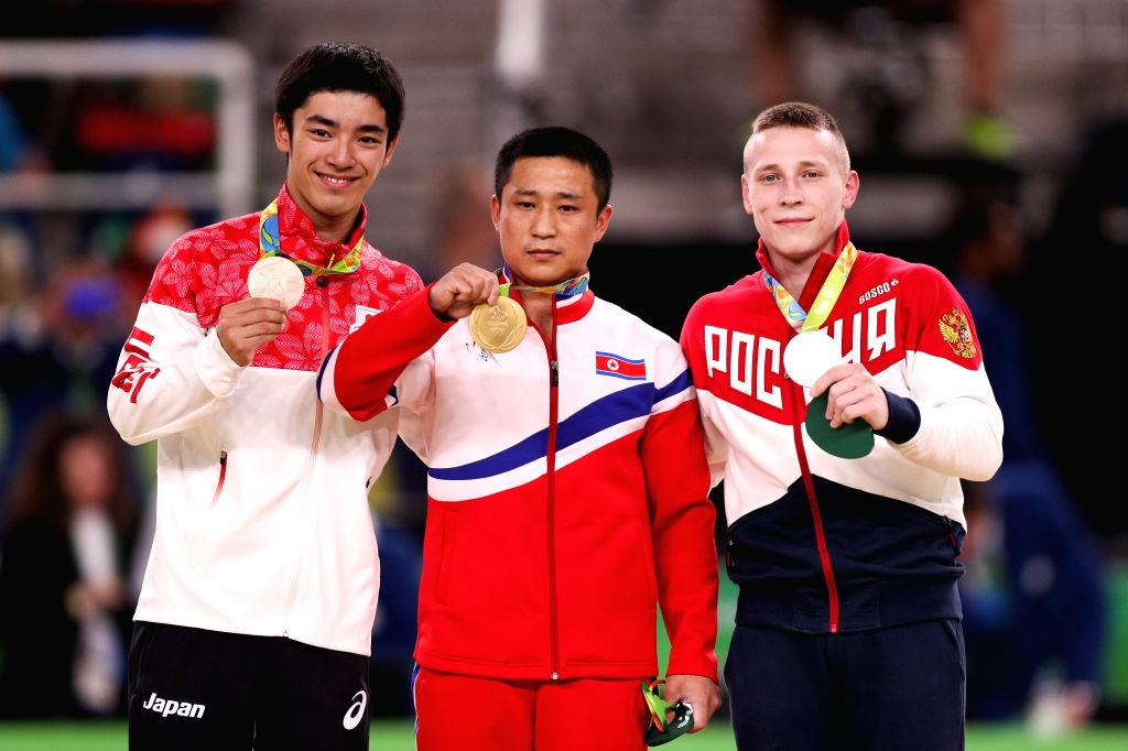 RIO DE JANEIRO, Aug. 15, 2016 - Gold medalist Ri Se Gwang (C) of the Democratic People's Republic of Korea (DPRK), silver medalist Russia's Denis Abliazin (R), bronze medalist Japan's Kenzo Shirai ...