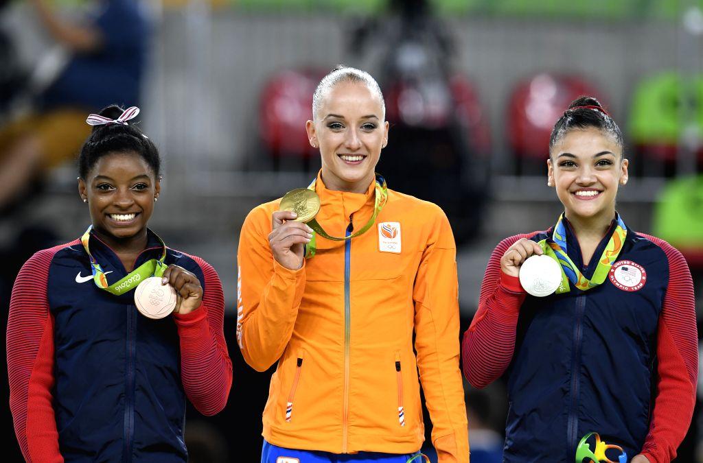 RIO DE JANEIRO, Aug. 15, 2016 - Gold medalist the Netherlands' Sanne Wevers (C), silver medalist Lauren Hernandez (R) of the United States of America, bronze medalist Simone Biles of the United ...