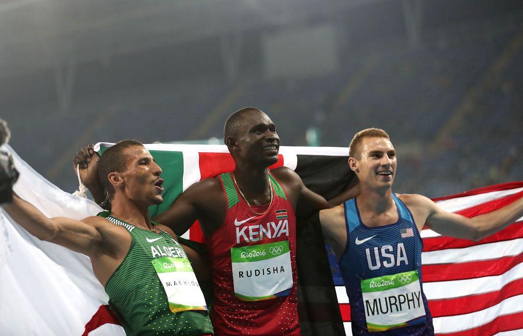 RIO DE JANEIRO, Aug. 15, 2016 - Lekuta David Rudisha of Kenya (C) celebrates after the men's 800m final at the 2016 Rio Olympic Games in Rio de Janeiro, Brazil, on Aug. 15, 2016. Lekuta David Rudisha ...