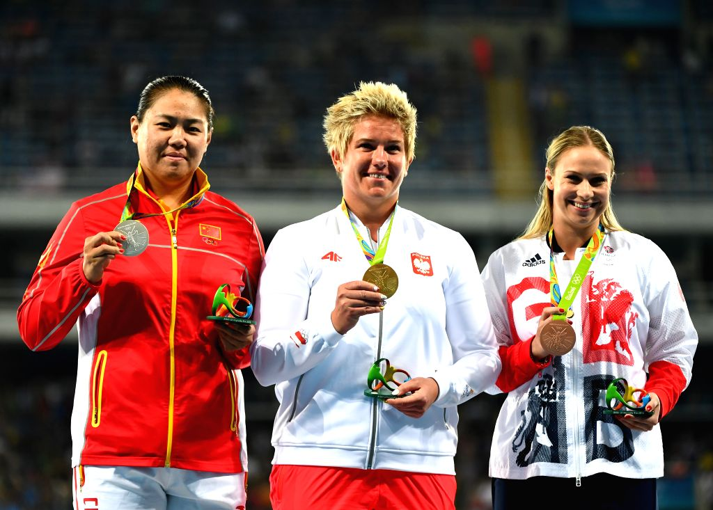 RIO DE JANEIRO, Aug. 15, 2016 - Poland's Anita Wlodarczyk (C), China's Zhang Wenxiu (L) and Sophie Hitchon of Great Britain attend the awarding ceremony of women's hammer throw at the 2016 Rio ...
