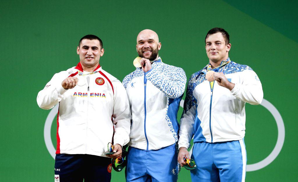 RIO DE JANEIRO, Aug. 15, 2016 - Ruslan Nurudinov of Uzbekistan (C), Simon Martirosyan of Armenia (L) and Alexandr Zaichikov of Kazakhstan attend the awarding ceremony of the men's 105KG weightlifting ...