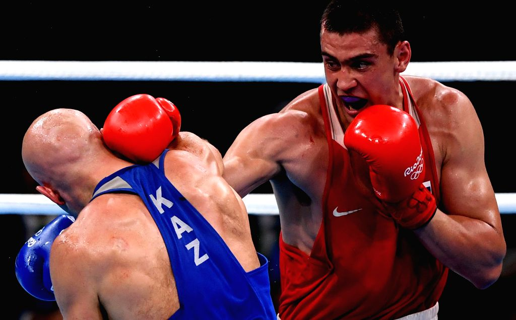 RIO DE JANEIRO, Aug. 15, 2016 - Russia's Evgeny Tishchenko (R) competes against Kazakhstan's Vassiliy Levit during the men's heavy(91KG) final of Boxing at the 2016 Rio Olympic Games in Rio de ...
