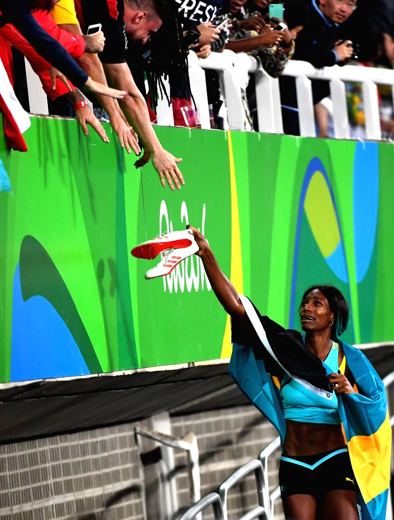 RIO DE JANEIRO, Aug. 15, 2016 - Shaunae Miller of Bahamas (R) celebrates after the women's 400m final at the 2016 Rio Olympic Games in Rio de Janeiro, Brazil, on Aug. 15, 2016. Shaunae Miller won the ...