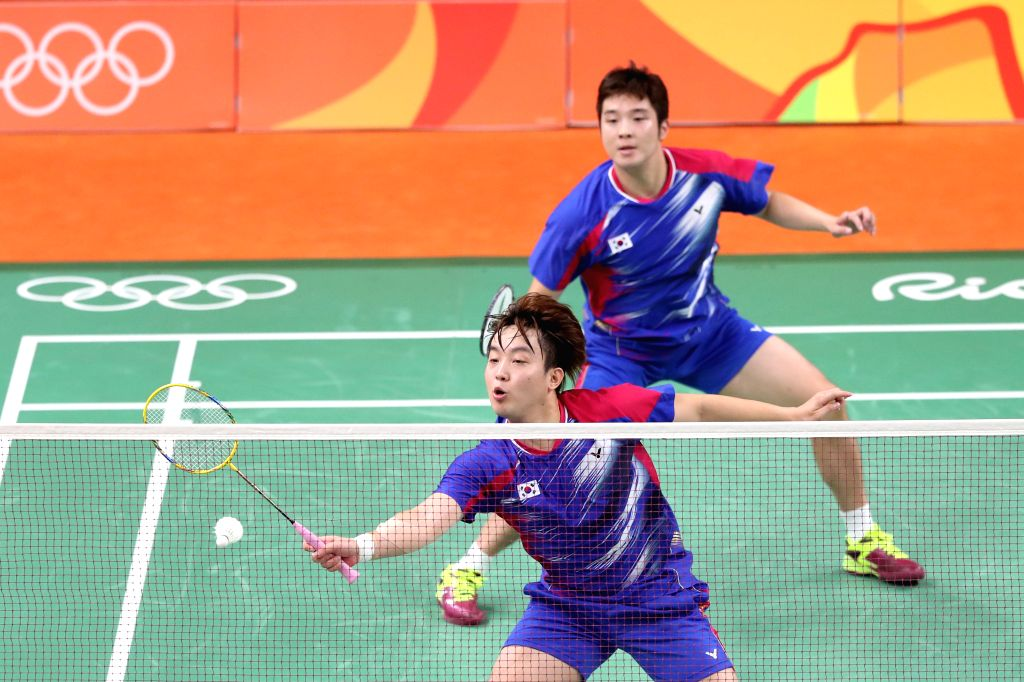 RIO DE JANEIRO, Aug. 15, 2016 - South Korea's Kim Gi Jung (behind) and Kim Sa Rang compete against China's Fu Haifeng and Zhang Nan during men's doubles quarterfinal of Badminton at the 2016 Rio ...