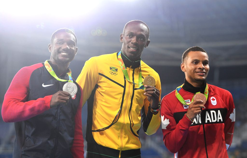 RIO DE JANEIRO, Aug. 15, 2016 - Usain Bolt of Jamaica (C), Justin Gatlin of the United States (L) and Andre de Grasse of Canada attend the awarding ceremony of men's 100m at the 2016 Rio Olympic ...