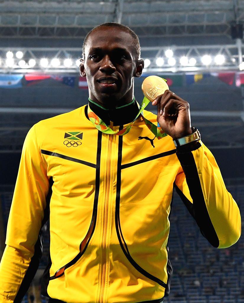 RIO DE JANEIRO, Aug. 15, 2016 - Usain Bolt of Jamaica shows the gold medal at the awarding ceremony of men's 100m at the 2016 Rio Olympic Games in Rio de Janeiro, Brazil, on Aug. 15, 2016. Usain Bolt ...