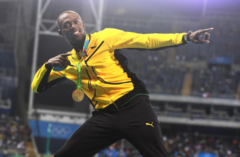 RIO DE JANEIRO, Aug. 15, 2016 - Usain Bolt of Jamaica attends the awarding ceremony of men's 100m at the 2016 Rio Olympic Games in Rio de Janeiro, Brazil, on Aug. 15, 2016. Usain Bolt won the gold ...